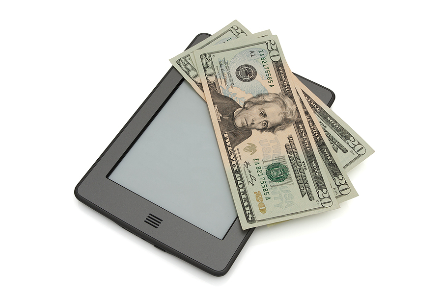 bigstock-Touch-E-reader-With-Money-28895156